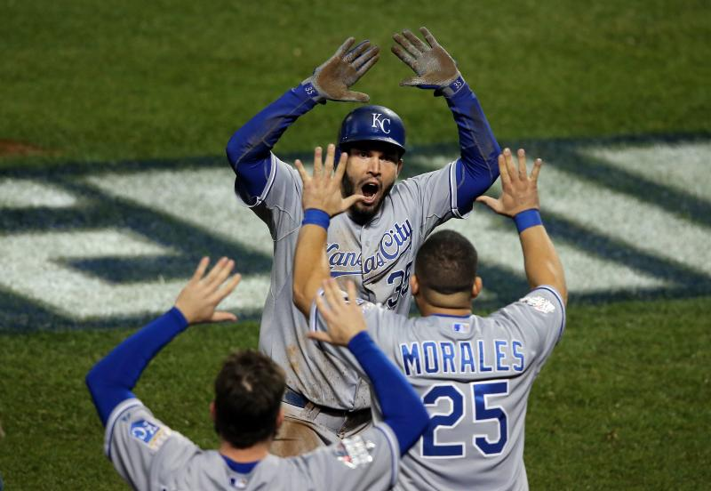 Eric Hosmer of the Kansas City Royals celebrates with his teammates after scoring a run to tie the game in the ninth inning against the New York Mets during Game 5 of the 2015 World Series.
