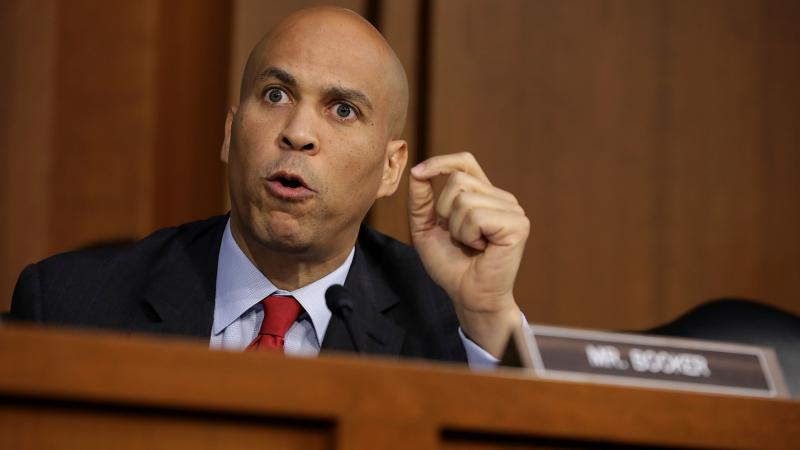 Sen. Cory Booker, D-N.J., argues with Republican members of the Senate Judiciary Committee during the third day of Supreme Court nominee Judge Brett Kavanaugh's confirmation hearings on Thursday.