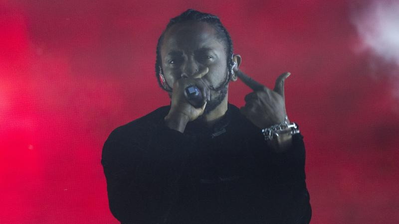 Kendrick Lamar performs at the 2017 Coachella festival. Though his 2015 album To Pimp A Butterfly wore its jazz influence on its sleeve, 2017's DAMN. displays Lamar's deep investment in the way jazz can evolve.