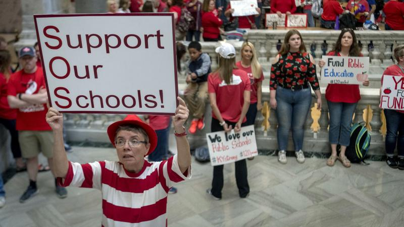 Teachers from across Kentucky gather outside the state Capitol to rally for increased funding for education on Friday, in Frankfort, Ky.