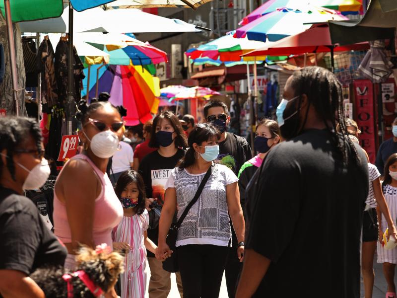 Shoppers, wearing masks to protect themselves from the  coronavirus, shop on Santee Alley in the Garment District in downtown Los Angeles this week.