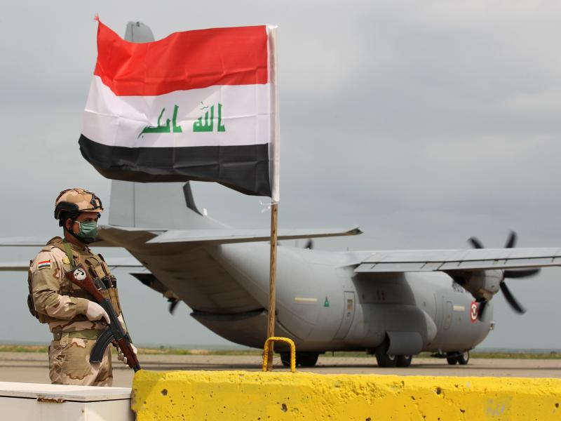 An Iraqi soldier stands guard near a U.S. military air carrier at the Qayyarah Airfield West, before the U.S. transferred the base to Iraqi forces in March.