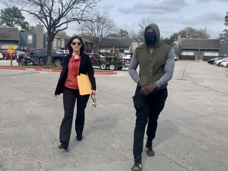 Landlord Stephanie Graves walks to the main office at one of her properties in Houston with a resident. She's going door to door offering to help residents apply for rental assistance money approved by Congress that's just starting to flow to landlords an