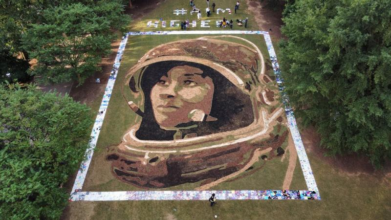 Artist Stan Herd's portrait of NASA astronaut Stephanie Wilson on display in Atlanta is 70 feet by 90 feet.