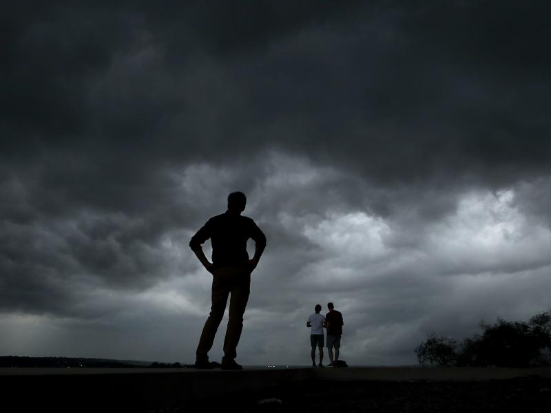 People watch from the Liberty Memorial as a severe storm that dropped several tornadoes earlier approaches downtown Kansas City, Mo., Tuesday, shortly before striking Douglas County, Kansas.