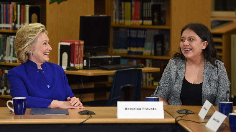 "Democratic presidential candidate and former U.S. Secretary of State Hillary Clinton speaks with student Betsaida Frausto on May 5 at Rancho High School in Las Vegas. Clinton said that any immigration reform would need to include a path to ""full and equal"