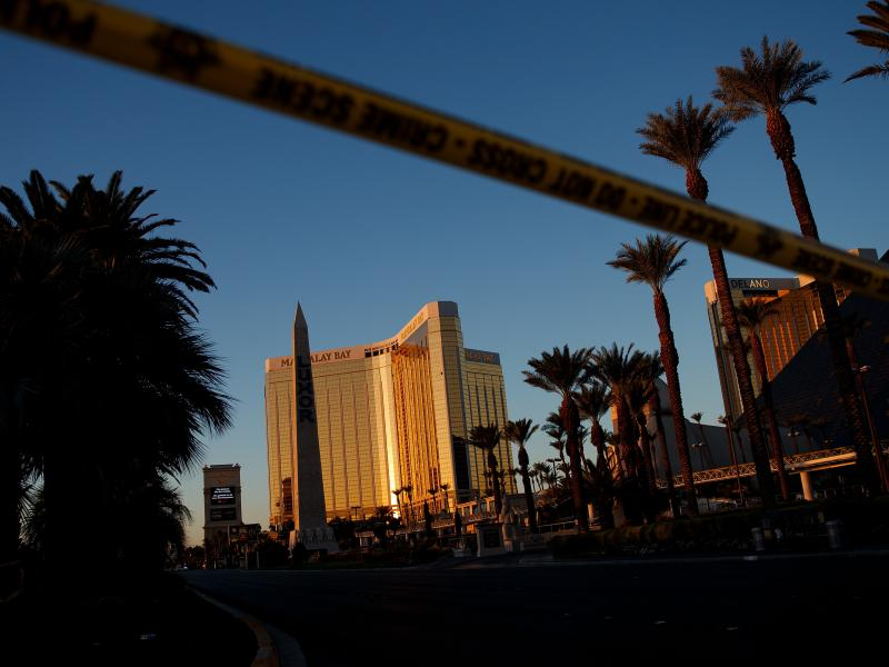 Police tape blocks off part of Las Vegas Blvd. on Tuesday near the scene of a massacre at a country music festival in Las Vegas, Nev. Twelve devices known as bump stocks, allowing a shooter to fire a weapon much more quickly, were found in the gunman's ro