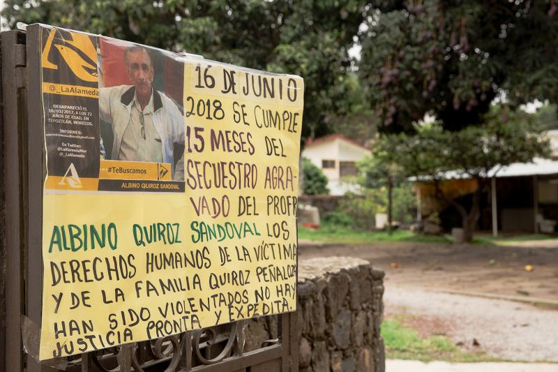 """A sign at the front of Quiroz's home reads: """"June 16, 2018, 15 months since the aggravated kidnapping of Professor Albino Quiroz Sandoval. The human rights of the victim and the family have been violated. There is no prompt and expeditious justice."""""""