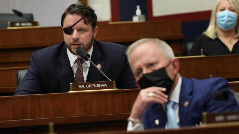 House Homeland Security Committee member Rep. Dan Crenshaw, R-Texas, questions witnesses during a hearing Thursday on threats to the United States.
