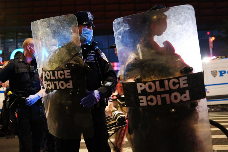 Police confront protesters in front of the Barclays Center in Brooklyn, NY, on May 29, 2020.