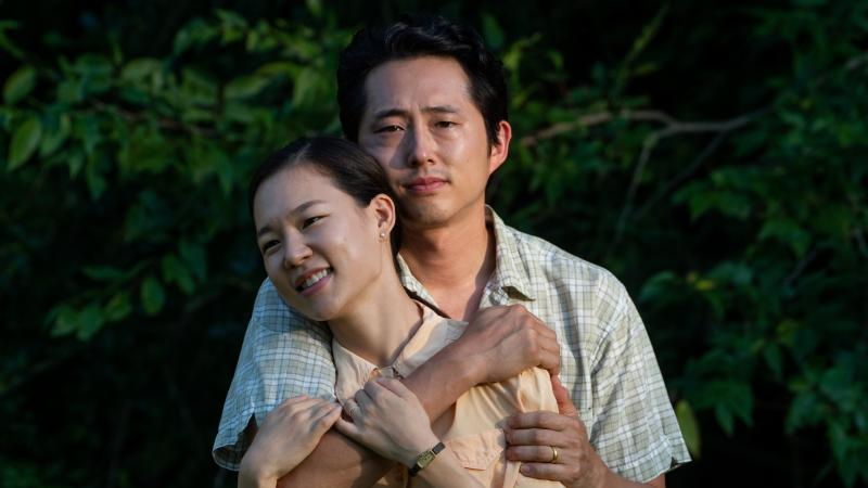 Married couple Jacob and Monica Yi (Steven Yeun and Yeri Han) relocate from California to a farm in Arkansas in the film Minari. Director Lee Isaac Chung says the film was inspired by his own rural upbringing.