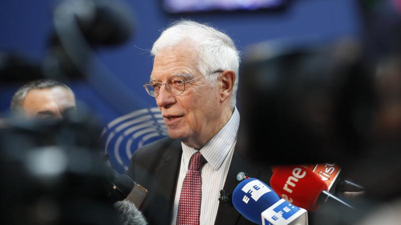 The European Union's foreign policy chief, Josep Borrell, talks to reporters Tuesday at the European Parliament in Strasbourg, France. The same day, the U.K., France and Germany announced they were lodging a dispute against Tehran under the Joint Comprehe