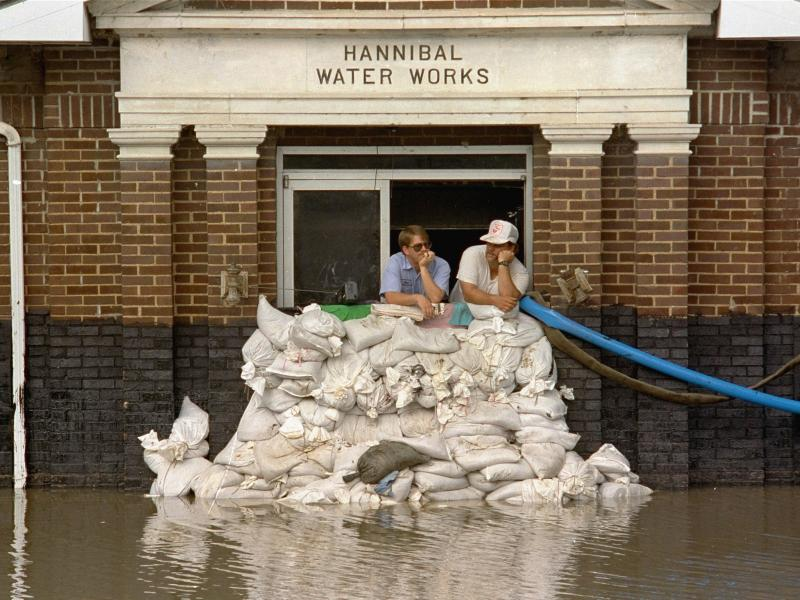 Mike Stone, left, and Andy Sherman in the pumping station for Hannibal, Mo., during a flood in 1993. The city has since constructed a flood wall, and flood managers have built up levees to protect against flooding. But scientists warn those structures are