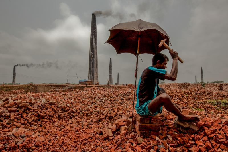 Breaking bricks is one of the lowest-paying jobs in Bangladesh. This photo was shot at a brick kiln in the Dhaka District, home to the capital city of Dhaka.