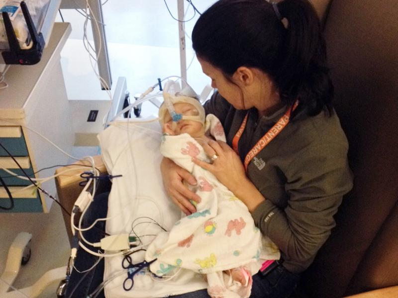 Amy Thomson holds 2-month-old Isla in Seattle Children's Hospital in early 2014. When the Thomson family learned Isla's heart was failing, they took an air ambulance from Butte, Mont., to Seattle to get medical care.