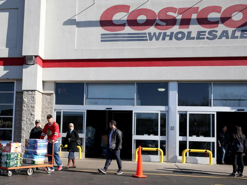 Shoppers line up to buy supplies at Costco Wholesale in New Jersey last year as fears over COVID-19 grew around the world. The company recently reintroduced limits on toilet paper, cleaning supplies and other products as it copes with supply chain challen