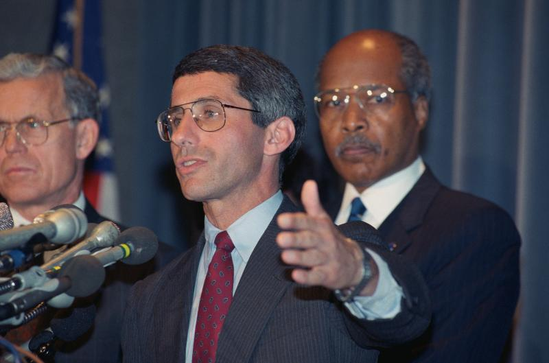 In 1989, Fauci and then-U.S. Health and Human Services Secretary Louis W. Sullivan (right) announced results of studies showing that the antiviral drug AZT had delayed the onset of disease in some people with HIV.