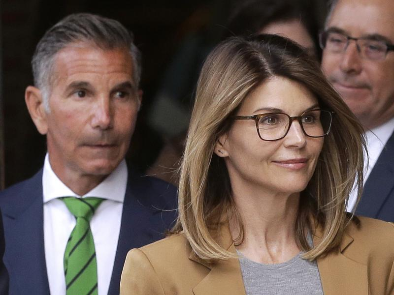 Actress Lori Loughlin and her husband, clothing designer Mossimo Giannulli (left) leave federal court in Boston earlier this month. On Monday they announced they would plead not guilty to charges in the Justice Department's college admissions case.