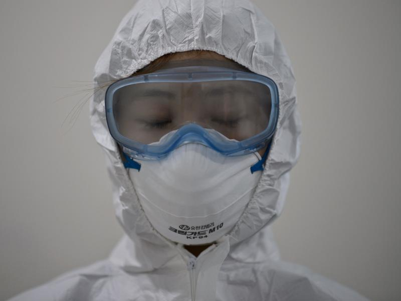 A medical staff member wearing a protective suit waits to enter an isolation ward for patients with Middle East respiratory syndrome, or MERS, in South Korea.