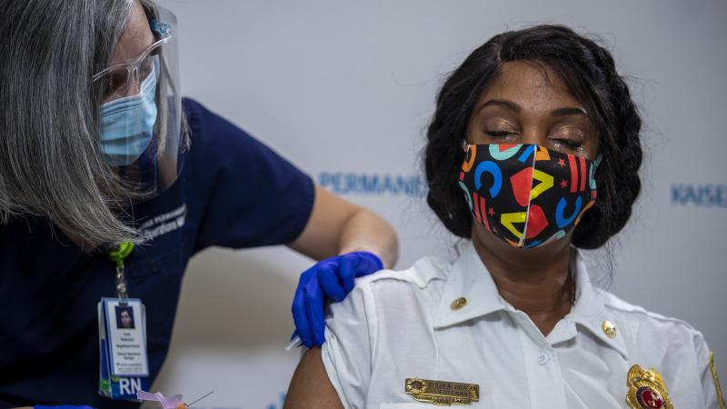 Washington, D.C., Fire and EMS Lt. Keishea Jackson gets a Pfizer coronavirus vaccine shot on Thursday.