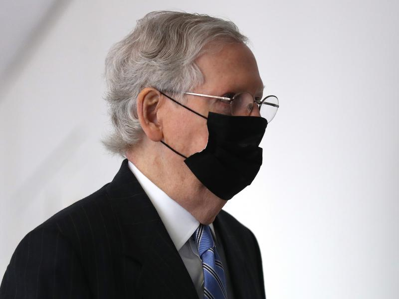 Senate Majority Leader Mitch McConnell arrives for a Republican Senate luncheon Wednesday on Capitol Hill.