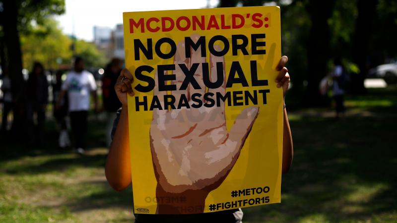 A McDonald's employee holds a sign during a 2018 protest against sexual harassment in the workplace in Chicago.