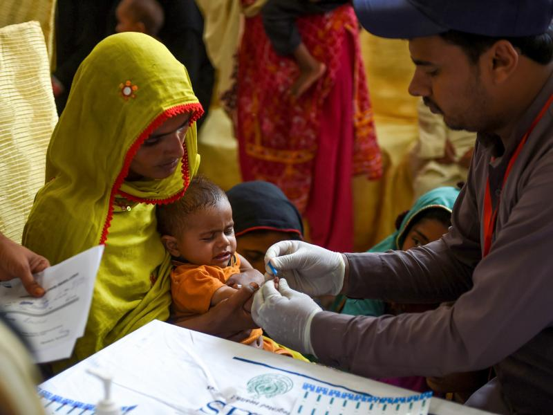 In Larkana, Pakistan, on May 9, 2019, a paramedic takes a blood sample from a baby for a HIV test. The government is offering screenings in the wake of an HIV outbreak.