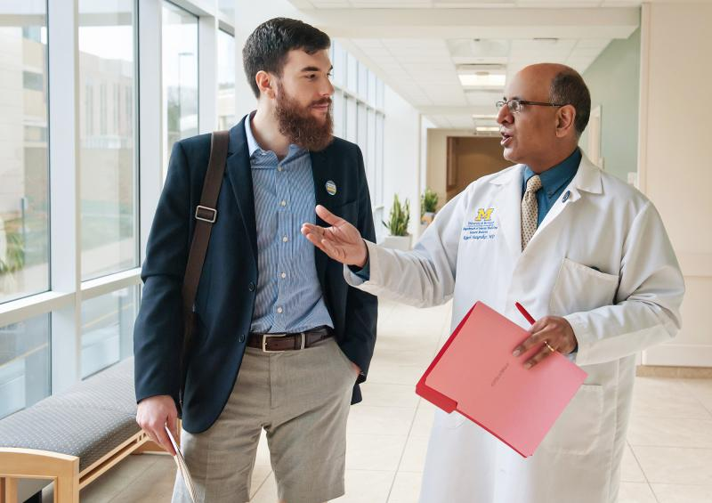 Dr. Raj Mangrulkar and medical student Jesse Burk-Rafel at the University of Michigan Medical School. Good communication skills, teamwork and adaptability will help doctors thrive through swift changes in medical science, Mangrulkar says.