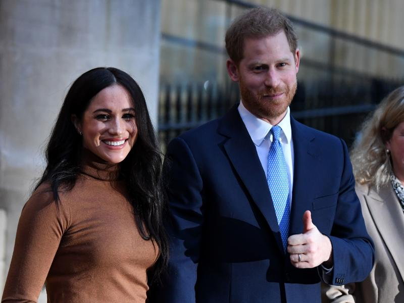 Meghan and Prince Harry as they leave Canada House in London on Tuesday.