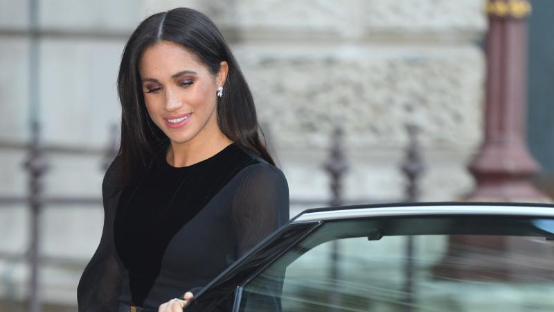 Meghan Markle, the Duchess of Sussex, makes headlines for closing her own car door upon arriving at the Royal Academy of Arts.