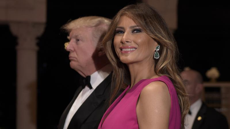 President Trump and first lady Melania Trump arrive for the 60th annual Red Cross Gala at Trump's Mar-a-Lago resort in Palm Beach, Fla., on Saturday.
