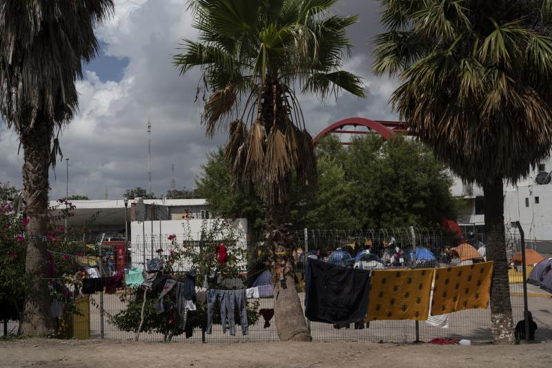 Drying migrants clothes in an encampment near the Gateway International Bridge in Matamoros, Tamaulipas. More than 1,500 asylum-seekers are living in the tent encampment.