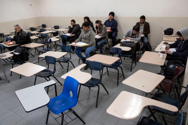 Male students attend to class during at the Universidad Autonoma de Baja California in Tijuana. Women were largely absent from classes in photos posted on social media.