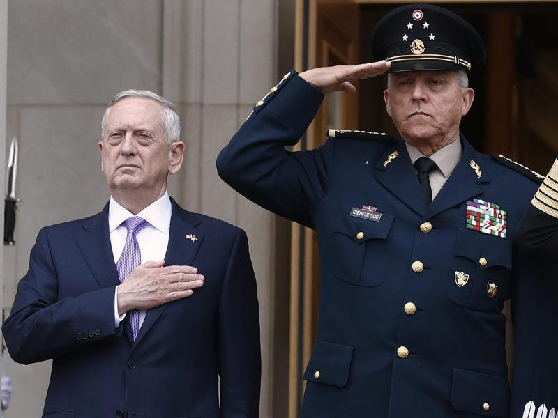 Former Defense Secretary Jim Mattis, left, and former Mexican Defense Secretary Gen. Salvador Cienfuegos Zepeda during an honor cordon at the Pentagon in 2017. Mexico cleared Cienfuegos of all charges related to drug trafficking on Thursday.