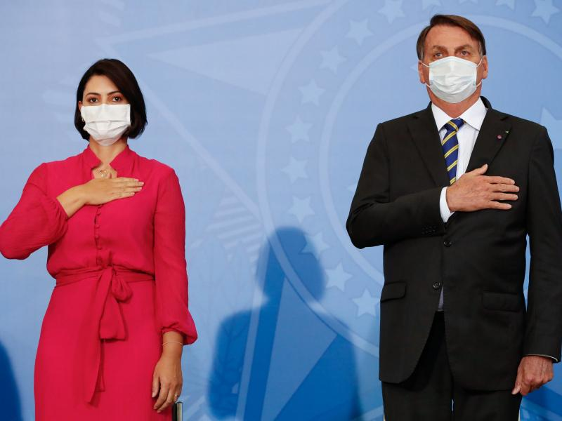 Michelle Bolsonaro tested positive on Thursday — days after her husband, Brazilian President Jair Bolsonaro, said he had recovered from the disease. The pair are seen here at an event on Wednesday.