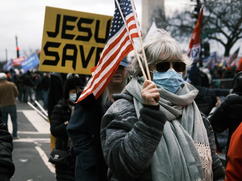 """""""JESUS SAVES"""" banners were among those carried during a rally on Jan. 6, 2021, in Washington before rioters stormed the Capitol."""