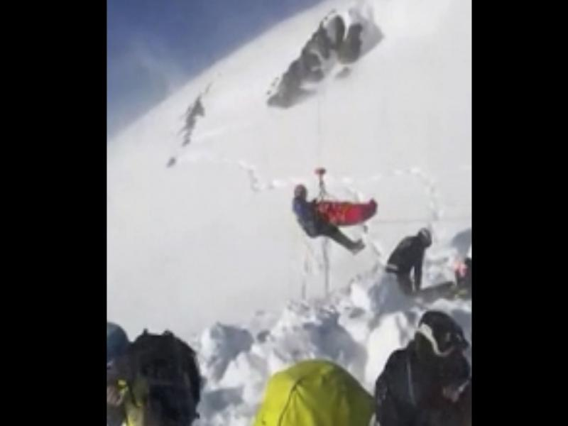 """In this grab taken from validated UGC provided on Thursday, Dec. 27, a boy is airlifted after an avalanche, on the French Alps on Wednesday. Rescuers are calling a true """"miracle."""""""