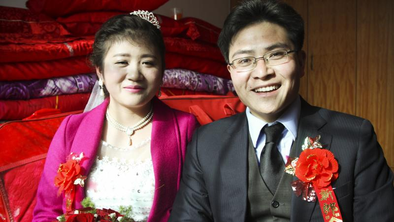 Charles and his bride Xiao Fang met through a social media app where they connected by shaking their smartphones at the same time. NPR's Frank Langfitt met Charles in Shanghai and drove him 500 miles to his family's home in central China for the wedding.