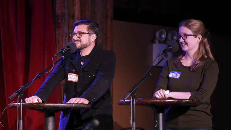 Contestants Paul Alexander and Sarah Sandkuhler face off in a game on Ask Me Another at the Bell House in Brooklyn, New York.