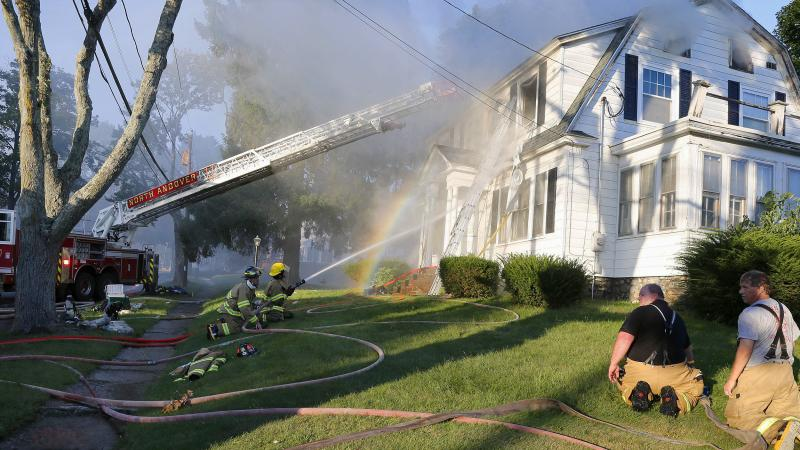 Firefighters battle a house fire in North Andover, Mass., one of a series of fires and gas explosions triggered Thursday by a problem with a gas line that feeds several communities north of Boston.