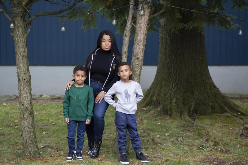 Farida Mercedes and her two sons Sebastian, 5, (left) and Lucas, 7, stand in their backyard in Fairlawn, N.J. Mercedes left her job as an assistant VP of HR at L'Oreal in August after working there for 17 years. As hundreds of thousands of women dropped o