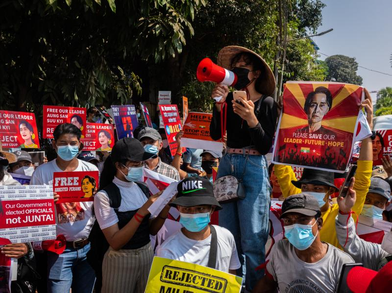 Protesters shout slogans and hold banners in front of the U.N. headquarters on Tuesday in Yangon, Myanmar, calling for the release of ousted leader Aung San Suu Kyi.