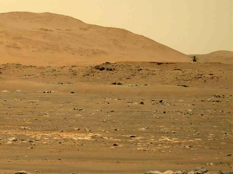 In this image taken by the Mars Perseverance rover and made available by NASA, the Mars Ingenuity helicopter, right, flies over the surface of the planet on Friday.