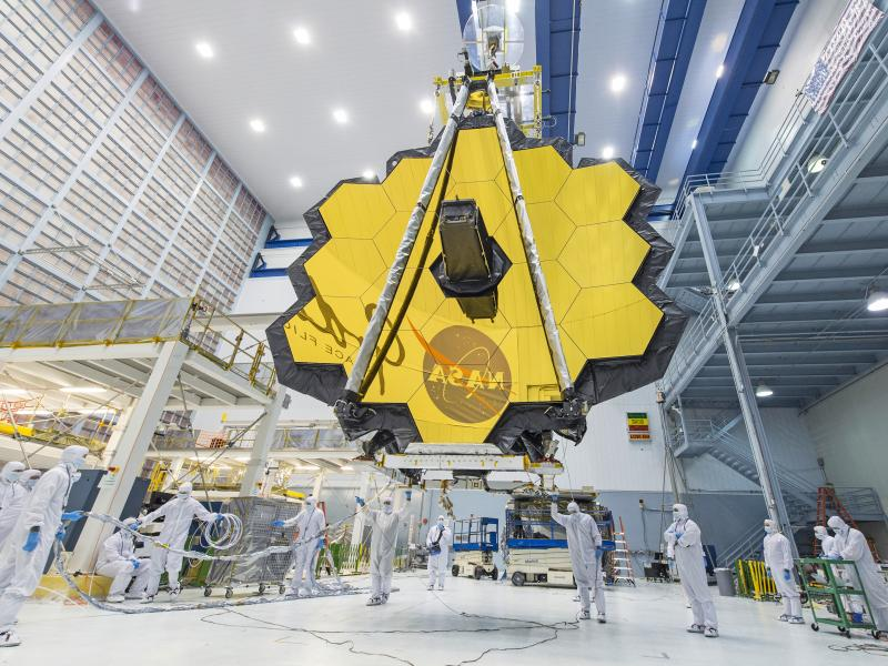 In 2017, technicians lift the mirror assembly of the James Webb Space Telescope using a crane inside a clean room at NASA's Goddard Space Flight Center in Greenbelt, Md.