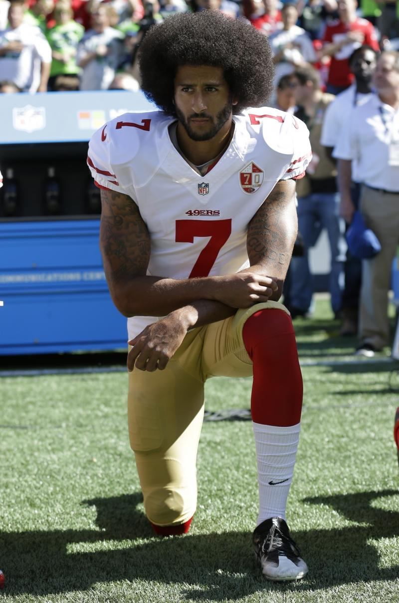 Then-San Francisco 49ers quarterback Colin Kaepernick kneels during the national anthem before a September 2016 game against the Seattle Seahawks in Seattle.
