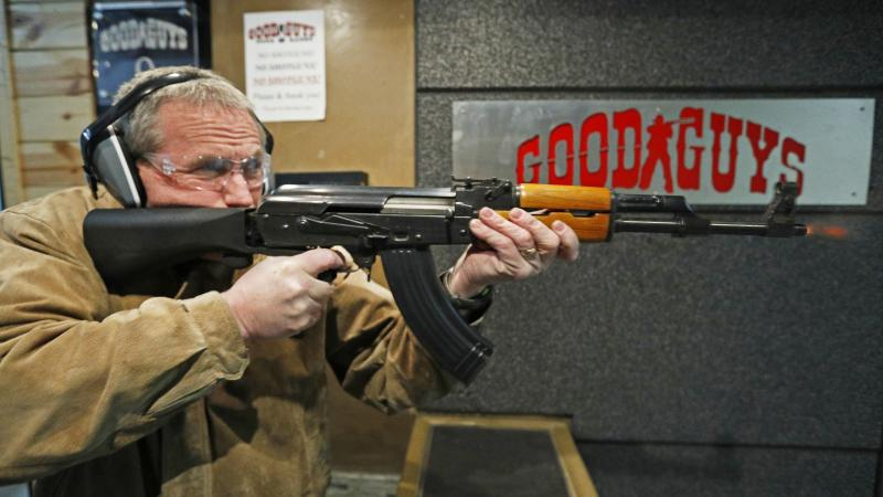 Vince Warner fires an AK-47 with a bump stock installed at Good Guys Gun and Range in Utah. A significant majority of Americans favor outlawing the attachment, according to the latest NPR/Ipsos poll.