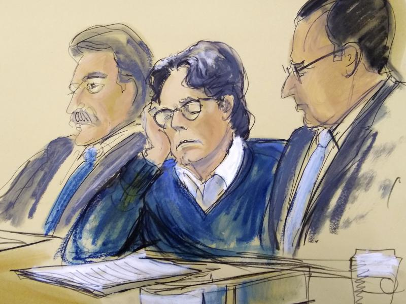 Keith Raniere was sentenced on Tuesday to 120 years in prison for his role as ringleader of the NXIVM cult, where he sexually abused several young women. In this June 2019 courtroom artist's sketch, Raniere, center, sits with his attorneys during closing
