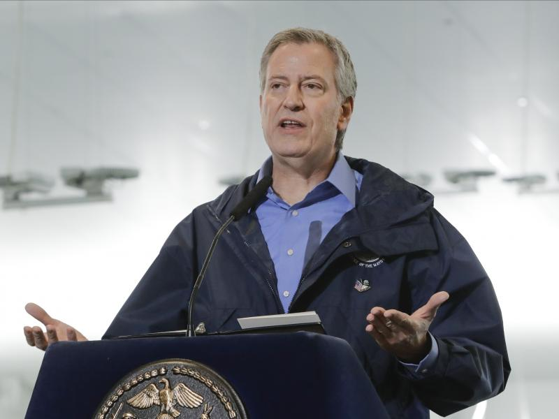 New York City Mayor Bill de Blasio speaks on March 31, 2020 at the USTA Indoor Training Center, the site of a makeshift hospital in New York. De Blasio is calling for a national enlistment program for doctors and nurses.