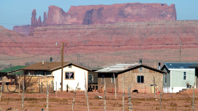 Houses on the Navajo Nation sit near sandstone cliffs north of Many Farms, Ariz. New Census Bureau estimates show a low rate of high-speed internet access among Native Americans who live on tribal land.