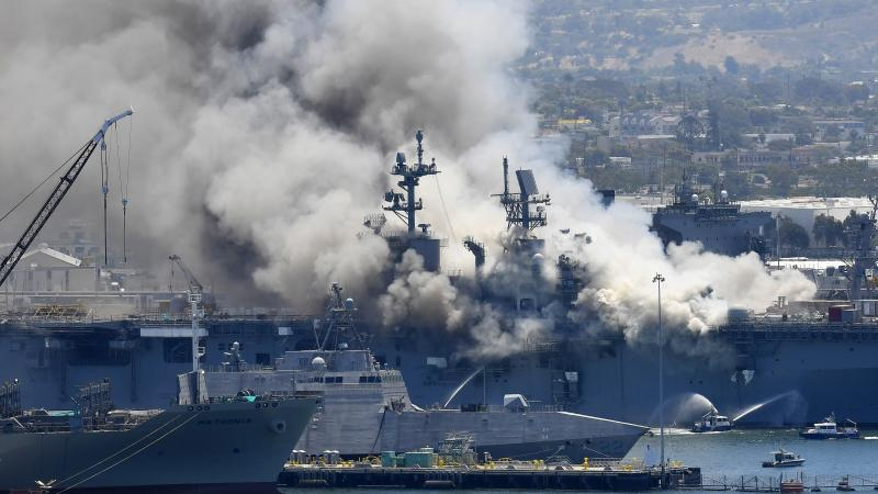 Smoke rises from the USS Bonhomme Richard after an explosion and fire on board the amphibious assault ship at Naval Base San Diego. The Navy is investigating whether the fire was due to arson.